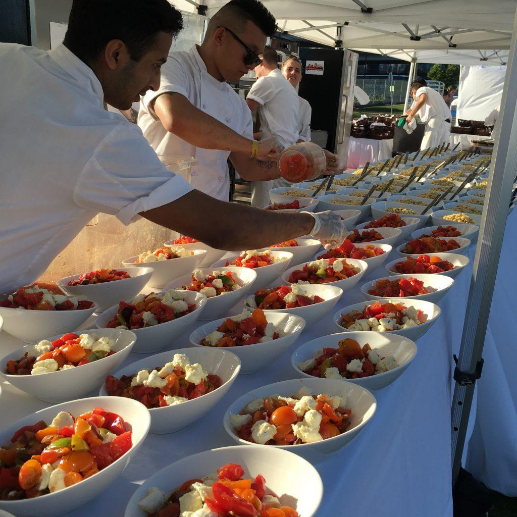 La Diner en Blanc Vancouver preparing meals